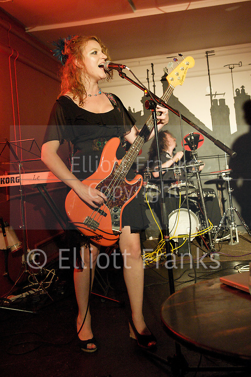 THE DISTRACTION CLUB<br /> at The Phoenix, Cavendish Square, London, Great Britain <br /> 6th September 2011 <br /> <br /> Kirsty Newton<br /> <br /> THE DISTRACTION CLUB is certain to become one of the most exciting and talked-about nights out in London.<br /> <br /> MITCH BENN (&quot;the country's leading musical satirist&quot;- The Times) and his band THE DISTRACTIONS (Kirsty Newton and Ivan Sheppard) are proud to host, on the first Tuesday of every month, THE DISTRACTION CLUB, a new regular evening of music and comedy in the heart of London's West End.<br /> <br /> The Distraction Club will feature regular guest performers, appearances by both new and established musical comedy acts, and special performances by well-known comedians displaying hitherto unsuspected musical skills and respected musicians exploring their own funny side...<br /> <br /> MITCH BENN &amp; THE DISTRACTIONS<br /> MITCH BENN is acknowledged as one of the best writer/performers of comic songs in Britain; as well as a mainstay of the comedy circuit he has been the resident songsmith on BBC Radio 4&amp;#8242;s THE NOW SHOW for over a decade. He has also contributed songs to Bremner, Bird &amp; Fortune on Channel 4 and Watchdog on BBC1.