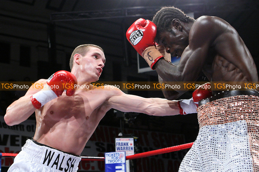 Liam Walsh (white shorts) defeats Maxwell Awuku in a Super-Featherweight boxing contest for the Commonwealth Title at York Hall, Bethnal Green, promoted by Frank Warren - 23/10/10 - MANDATORY CREDIT: Gavin Ellis/TGSPHOTO - Self billing applies where appropriate - Tel: 0845 094 6026