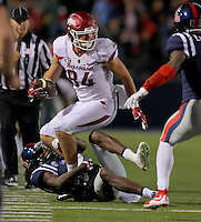 11/7/15<br /> Arkansas Democrat-Gazette/STEPHEN B. THORNTON<br /> Arkansas's Hunter Henry looks for a teammate to LATERAL the ball to as he is brought down by Ole Miss' Tony Bridges on 4th and 25 in overtime during Saturday's game in Oxford, Miss. Henry's pass was complete to Alex Collins for a first down.