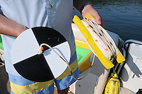 NWA Democrat-Gazette/FLIP PUTTHOFF<br /> 10 YEARS FOR SECCHI DAY<br /> A Secchi Disk is used to measure water clarity. When the disk sinks into the water, the depth is recorded when the disk can no longer be seen. The clarity of Beaver Lake ranges from a few feet at the headwaters to 15 feet or more near the dam.<br /> <br /> <br /> Doug Wagley lowers a Secchi Disk into the water to measure the clarity of Beaver Lake on Saturday August 15 2015 while Andrew Sharpley records data during the 10th annual Secchi Day. Teams of volunteers fanned out on all areas of the lake to measure the water's transparency with a Secchi Disk. Data is compiled at Prairie Creek park where volunteers eat a complimentary lunch, see educational exhibits and win door prizes. Data from 10 years of Secchi Day events helps water officials spot any trends or changes in the clarity of the reservoir, said Bob Morgan with the Beaver Water District, which provides drinking water to most of the region. Beaver Lake is the water source for Northwest Arkansas and beyond.
