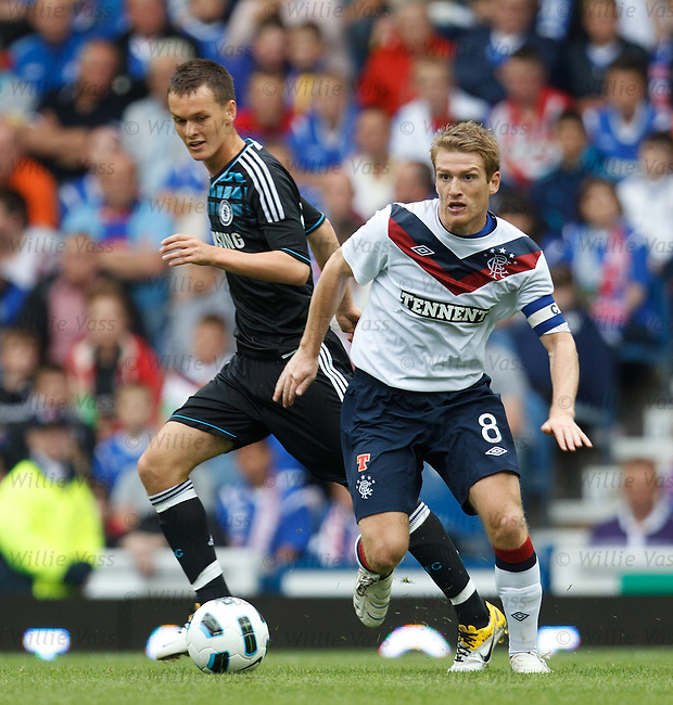 Steven Davis comes away from Chelsea's Josh McEachran
