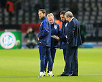 England's Gary Neville, Roy Hodgson and Ray Lewington look at the teamsheet during the International Friendly match at Olympiastadion.  Photo credit should read: David Klein/Sportimage