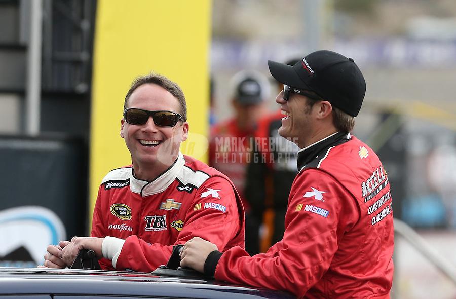 Mar. 3, 2013; Avondale, AZ, USA; NASCAR Sprint Cup Series driver Dave Blaney (left) with J.J. Yeley during the Subway Fresh Fit 500 at Phoenix International Raceway. Mandatory Credit: Mark J. Rebilas-