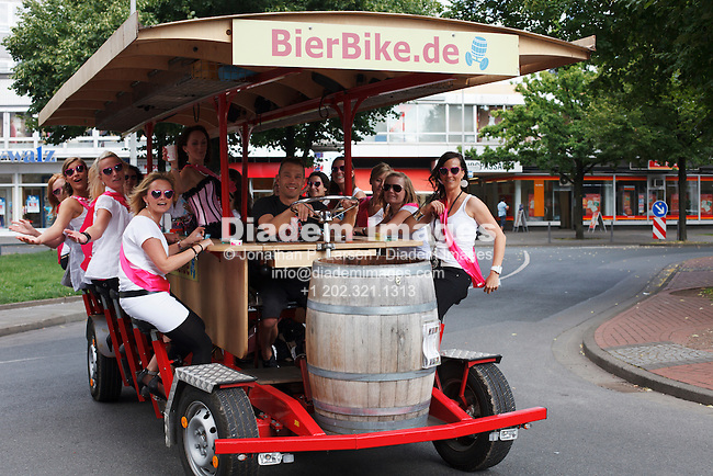 Young women pedal a bier bike in Hannover, Germany.