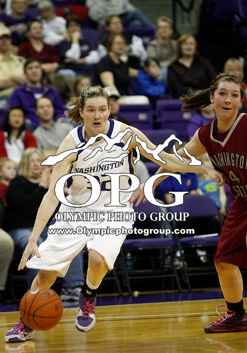 27 February 2010:  Washington Huskies guard #32 Sami Whitcomb drives past Washington State's #4 Katie Grad as she heads to the basket. Washington won 70-54 over Washington State at the Bank of America Arena in Seattle, WA.