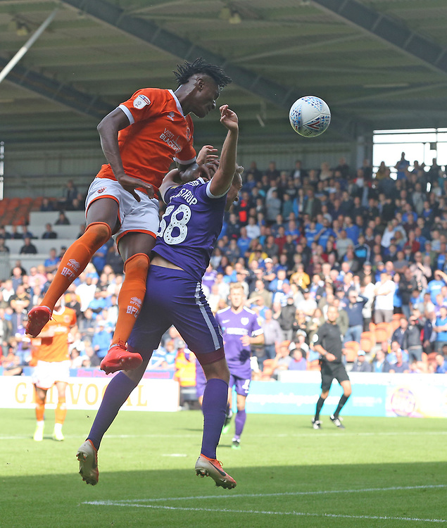 Blackpool's Armand Gnanduillet and Portsmouth's Brandon Haunstrup<br /> <br /> Photographer Stephen White/CameraSport<br /> <br /> The EFL Sky Bet League One - Blackpool v Portsmouth - Saturday 31st August 2019 - Bloomfield Road - Blackpool<br /> <br /> World Copyright © 2019 CameraSport. All rights reserved. 43 Linden Ave. Countesthorpe. Leicester. England. LE8 5PG - Tel: +44 (0) 116 277 4147 - admin@camerasport.com - www.camerasport.com