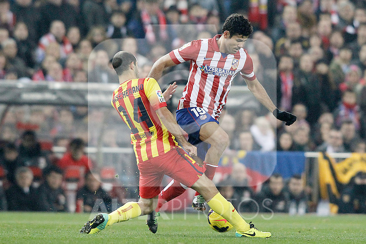 Atletico de Madrid's Diego Costa (r) and FC Barcelona's Javier Mascherano during La Liga match.January 11,2014. (ALTERPHOTOS/Acero)