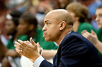January 14, 2010:   Jacksonville head coach Cliff Warren cheers his team during  Atlantic Sun conference game action between the Jacksonville Dolphins and the Lipscomb Bisons at Veterans Memorial Arena in Jacksonville, Florida.  Jacksonville defeated Lipscomb 79-73.