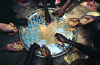 Mali. Province of Segou. Cinzana. Cinzana Agricultural Research Station is run by the Mali Institut d'Economie Rurale and a sponsorship of Syngenta Foundation for sustainable agriculture. Traditionnal food  ( couscous and meat) was cooked and eaten on an open day by the farmers children.© 2003 Didier Ruef