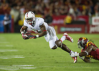 LOS ANGELES, CA - November 16, 2013:  Stanford Cardinal wide receiver Ty Montgomery (7) gets tripped up during the Stanford Cardinal vs the USC Trojans at Los Angeles Memorial Coliseum in Los Angeles, CA. Final score Stanford Cardinal 17, USC Trojans  20.