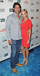 """Camille Grammer and date at the book party hosted by Bravo for """"Most Talkative Stories from the Front Line of Pop Culture"""" held at SUR Lounge in West Hollywood May 14, 2012. © Fitzroy Barrett"""