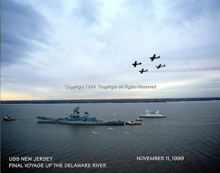 Aerial view of the USS New Jersey and WWII flyover along the Delaware River
