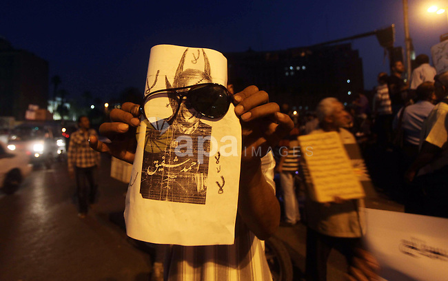 Egyptian protesters attend a demonstration, against presidential candidates Mohammed Morsi and Ahmed Shafiq at Tahrir Square in Cairo May 29, 2012. According to full official results released Monday by the election commission. Commission chief Farouq Sultan said in a press conference that the Brotherhood's Mohammed Morsi and Ahmed Shafiq, a former air force commander and a longtime friend of the ousted leader, were the top two finishers in the first round of voting held on May 23-24. Photo by Ashraf Amra
