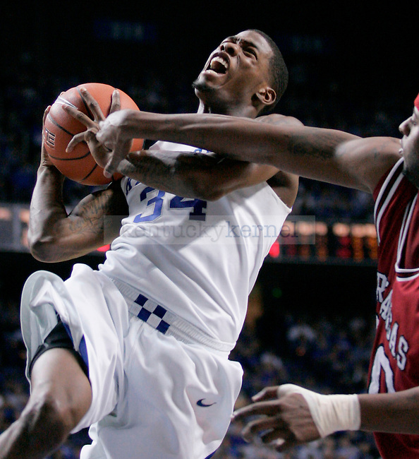 Sophomore guard DeAndre Liggins is fouled as he goes up for a layup during the second half of the game against Arkansas at Rupp Arena on Saturday.  Photo by Zach Brake | Staff..