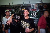 OAKLAND, CA - Tim Hudson of the Oakland Athletics celebrates in the clubhouse with a can of Budweiser beer  after they beat the Texas Rangers to clinch the America League West at the Oakland Coliseum in Oakland, California on October 1, 2000. (Photo by Brad Mangin)