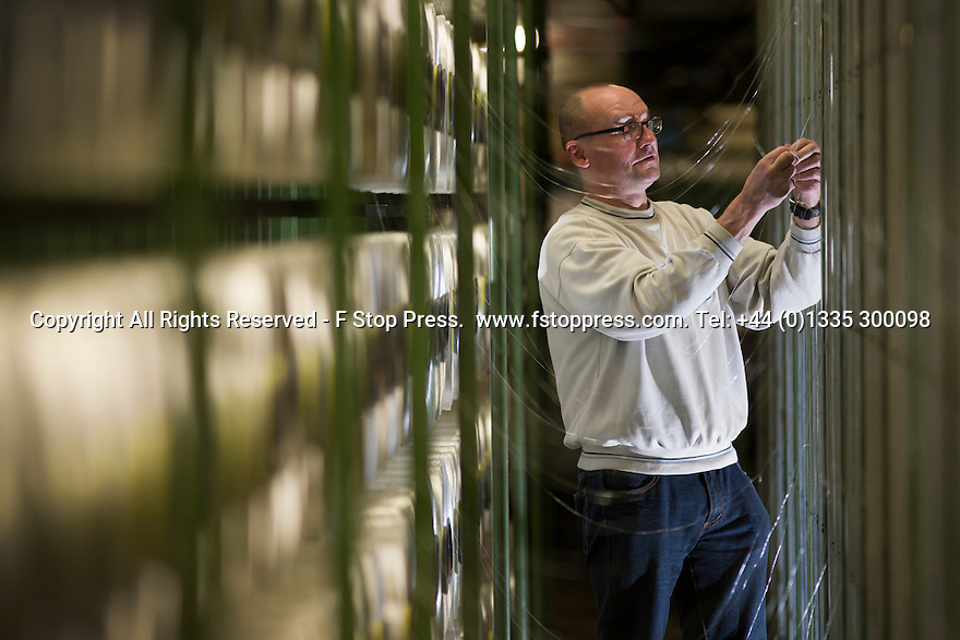 13/01/15<br /> <br /> <br /> Rob Waring, 53, Production Operator, 'tying-in' yarns. <br /> <br /> <br /> Full story here: http://www.fstoppress.com/articles/mayfield-yarns/<br /> <br /> If you've ever struggled to untangle the wires on your headphones, an electrical extension cable or a reel of fishing line, then spare a thought for the workers at Britain's largest yarn processors who are responsible for keeping 2½ million metres of gossamer-thin thread, tangle and snag-free each week...<br /> <br /> ***ANY UK EDITORIAL PRINT USE WILL ATTRACT A MINIMUM FEE OF £130. THIS IS STRICTLY A MINIMUM. USUAL SPACE-RATES WILL APPLY TO IMAGES THAT WOULD NORMALLY ATTRACT A HIGHER FEE . PRICE FOR WEB USE WILL BE NEGOTIATED SEPARATELY - EXISTING AGREEMENTS FOR WEBUSE APPLY***<br /> All Rights Reserved - F Stop Press.  www.fstoppress.com. Tel: +44 (0)1335 300098