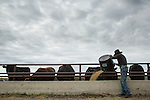 Charl Gould, a rancher near Consort, Alberta feeds his cattle. Although the proposed Energy East pipeline does not run on the Gould's ranch, they are concerned by the project and the petro state that Canada appears to be developing. (Credit: Robert van Waarden - http://alongthepipeline.com)