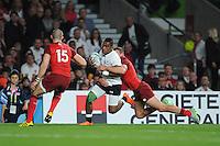 Nikola Matawalu of Fiji is tackled during Match 1 of the Rugby World Cup 2015 between England and Fiji - 18/09/2015 - Twickenham Stadium, London <br /> Mandatory Credit: Rob Munro/Stewart Communications