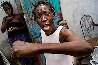 An angry woman shouts and accuses the US together with the United Nations for being a cause of the deep poverty and overall misery in the slum of Cité Soleil, Port-au-Prince, Haiti, 22 July 2008. The overall situation on Haiti gets worse every year and the extreme, hardly imaginable poverty hits more and more people. The Haitian economics is paralysed, there is no infrastructure, no food supplies, the population suffer from hunger, social and living conditions in Haitian slums (e.g. Cité Soleil) are a human tragedy. The rage grows and the tension continues with undiminished strength.