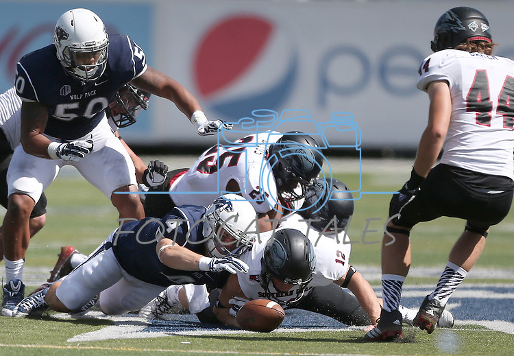 Nevada and Southern Utah special teams scramble for a loose ball after an onside kick during the second half of an NCAA college football game on Saturday, Aug. 30, 2014 in Reno, Nev. Nevada defeated Southern Utah 28-19. (AP Photo/Cathleen Allison)