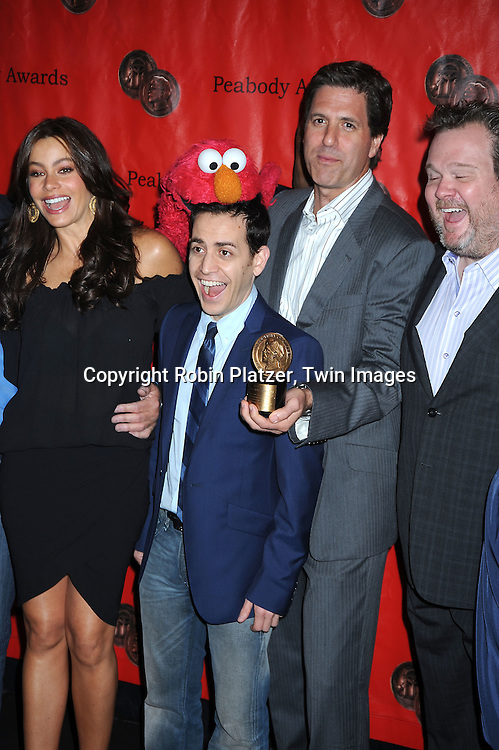 Sofia Vergara and  the cast of Modern Family with Elmo posing for photographers at the 69th Annual Peabody Awards on May 17, 2010 at The Waldorf Astoria Hotel in New York City.