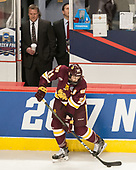 Scott Sandelin (UMD - Head Coach), Carson Soucy (UMD - 21) - The University of Denver Pioneers defeated the University of Minnesota Duluth Bulldogs 3-2 to win the national championship on Saturday, April 8, 2017, at the United Center in Chicago, Illinois.