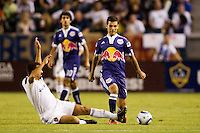 LA Galaxy forward Jovan Kirovski attempts a slide tackle of Rafael Marquez of the New York Red Bulls leaps. The New York Red Bulls beat the LA Galaxy 2-0 at Home Depot Center stadium in Carson, California on Friday September 24, 2010.