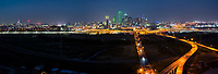 This aerial pano of the Dallas skyline after dark shows the city with the roads as they lead into downtown over the Trinity river. This panorama also includes the city well know bridge the Margaret Hunt Hill and the latestest edition the Margaret McDermott Bridge. The city includes all the important skyscrapers like the 72 floor Bank of America, Comercia Bank, the landmark Reunion Tower, Fountain Place and the Omni Hotel along with many other high rise buildings. Dallas Skyline Stock photos.