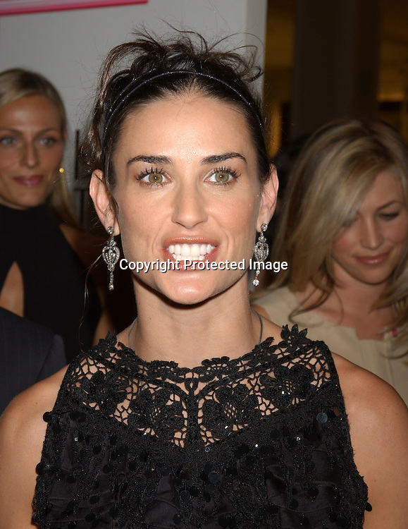 ..Demi Moore in Oscar de La Renta dress ..at the Saks Fifth Avenue's Key to the Cure Celebrity Launch on September 17, 2003 in New York City. ..Photo By Robin Platzer, Twin Images