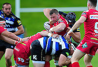 Morgan Allen of the Scarlets is tackled. Pre-season friendly match, between the Scarlets and Bath Rugby on August 20, 2016 at Eirias Park in Colwyn Bay, Wales. Photo by: Patrick Khachfe / Onside Images