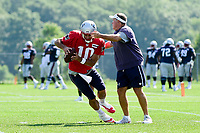 August 1, 2017: New England Patriots head coach Bill Belichick blocks the progress of quarterback Jimmy Garoppolo (10) at the New England Patriots training camp held at Gillette Stadium, in Foxborough, Massachusetts. Eric Canha/CSM
