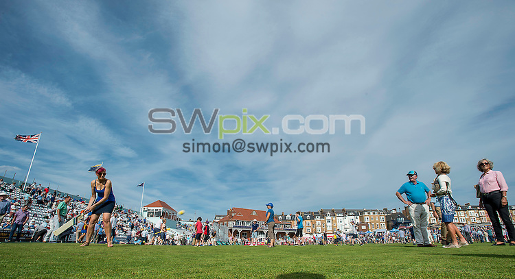 Picture by Allan McKenzie/SWpix.com - 23/08/2016 - Cricket - Specsavers County Championship - Yorkshire County Cricket Club v Nottinghamshire County Cricket Club - North Marine Road, Scarborough, England - Full house crowds of supporters at Scarbrorough's North Marine Road ground on the outfield during the break.