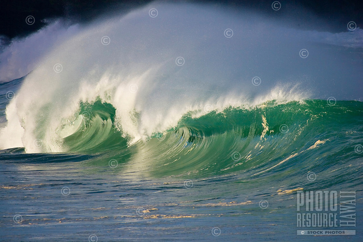 Beautiful empty wave at the Waimea Bay shore break on the North Shore of Oahu, Hawaii