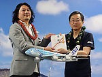 March 6, 2017, Tokyo, Japan - All Nippon Airways (ANA) president Osamu Shinobe (R) gives the round ticket between Tokyo and Honolulu to designer Chihiro masuoka (L) as he wins the design contenst of ANA's Airbus A380 jetliner at the ANA headquarters  in Tokyo on Monday, March 6, 2017. The turtle designed A380 will be introduced on the Tokyo-Honolulu service, launching in spring 2019.    (Photo by Yoshio Tsunoda/AFLO) LwX -ytd-