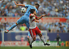 Connor Lade #5 of New York Red Bulls, front, and Jack Harrison #11 of NYC Football Club battle for a header during a Major League Soccer match against the New York Red Bulls at Yankee Stadium on Sunday, July 3, 2016. NYCFC won by a score of 2-0.