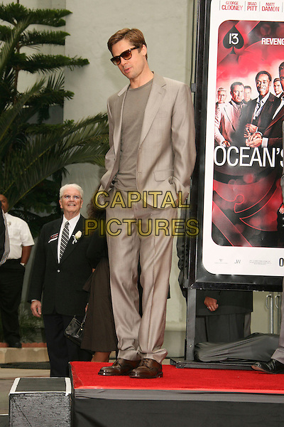 """BRAD PITT.""""Ocean's Thirteen"""" Handprint and Footprint Ceremony held  at Grauman's Chinese Theatre, Hollywood, California, USA..June 5th, 2007.full length hands in pockets beige suit jacket sunglasses shades .CAP/ADM/RE.©Russ Elliot/AdMedia/Capital Pictures"""