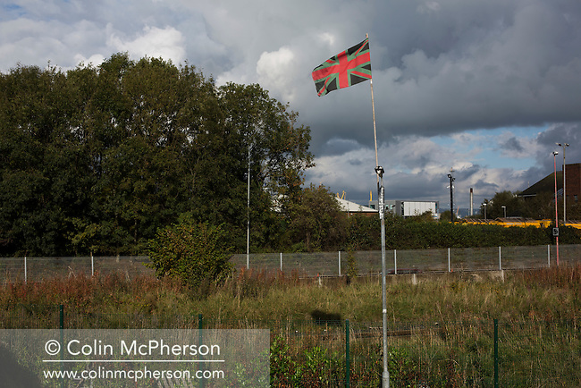 A Union flag in home team colours next to the away fans' entrance at The Oval, Belfast, pictured before Glentoran hosted city-rivals Cliftonville in an NIFL Premiership match. Glentoran, formed in 1892, have been based at The Oval since their formation and are historically one of Northern Ireland's 'big two' football clubs. They had an unprecendentally bad start to the 2016-17 league campaign, but came from behind to win this fixture 2-1, watched by a crowd of 1872.