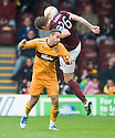 MOTHERWELL'S TOM HATELEY  AND HEARTS' MARIUS ZALIUKAS CHALLENGE FOR THE BALL
