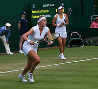 England, London, 25.06.2014. Tennis, Wimbledon, AELTC, Ladies Double Michaella Krajicek (NED) (L) with her doubles partner Lucie Miradacia (CZE)<br /> Photo: Tennisimages/Henk Koster