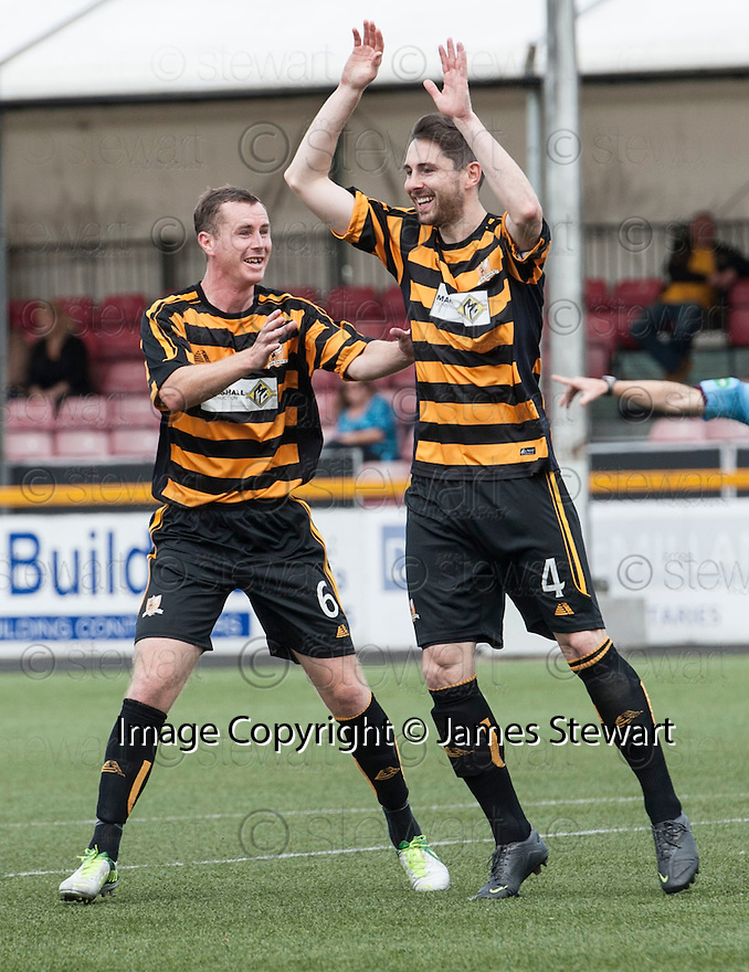 Alloa's Ben Gordon (4) celebrates with Stephen Simmons (6) after he scores their first goal.