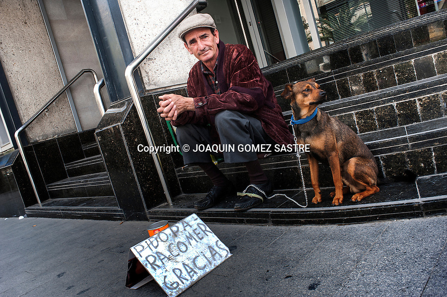 "Francisco and his trusty dog Manyi, are some of the usual faces we see begging on the street and a sign with the brief message ""ask to eat thanks"""