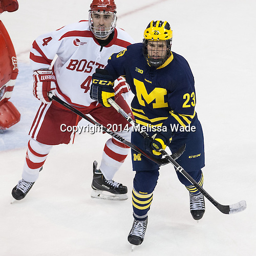 Brandon Hickey (BU - 4), Alex Kile (Michigan - 23) - The Boston University Terriers defeated the visiting University of Michigan Wolverines 3-2 on Saturday, October 25, 2014, at Agganis Arena in Boston, Massachusetts.