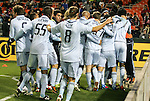 10 March 2012: Kansas City's C.J. Sapong is mobbed by teammates after scoring the game's only goal. Sporting Kansas City defeated DC United 1-0 at RFK Stadium in Washington, DC in a 2012 regular season Major League Soccer game.