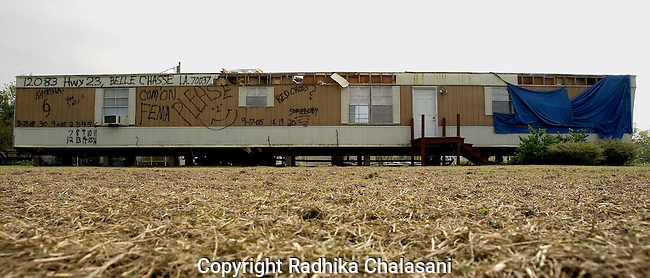 Belle Chase Highway, Louisiana - September 30:  Jay Michel uses his trailer home and its proximity to the highway to make a political statement regarding the slowness of the aid process to victims of Hurricane Katrina request help from FEMA September 30, 2005  near Ironton, Louisiana.(Photo by Radhika Chalasani)