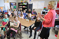 NWA Democrat-Gazette/DAVID GOTTSCHALK  Martha Londagin, a loan officer with Legacy National Bank, speaks Friday, March 16, 2018, to fourth grade students in Candra (cq) Osnes (cq), class at Lincoln Middle School during Career Fair Day at school. The fair featured representatives from 20 job fields visiting classrooms, a wax museum and student grant proposals for funding of school improvement projects.