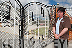 Mark Emerald Elvis Leen outside his home with the replica Gracelands gates at the entrance..