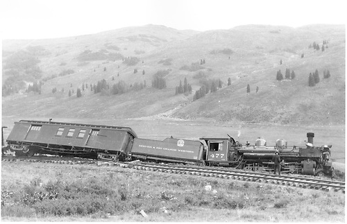 #477 with tender and RPO derailed at Cumbres.<br /> D&amp;RGW  Cumbres, CO