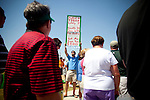 "Patrons of The Masters Golf Tournament make their way past Christian Seklecki, of Augusta, as he holds up a sign reading ""Pulled a Tiger lately? Smooth it over with fine jewelery"" just across the street from The Augusta National Golf Club on the second practice day of the Augusta, Georgia Masters Golf Tournament, April 6, 2010. Selecki is hoping to sell a $3,250 gift certificate to a local jewelers for $2,500."