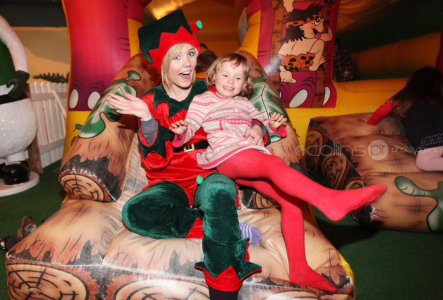 ****NO FEE PIC ******.19/11/2011.Santas Helper Jennifer Nolan & Genevieve Prenderville (3) from Monkstown.at the opening of Santa's Playland in The Ambassador Theatre,Dublin.One of this Christmas' biggest events is coming!  Santa's Playland takes up residence at The Ambassador Theatre in preparation for this year's festive season.  The spectacular event opens on Saturday 19 November and runs until Friday 23 December. Santa's Playland will see children transported to a magical Christmas paradise.On entering Santa's Playland children will be treated to a special Christmas play time.  The Play Area is full of Christmas treats with bouncy castles, slides and Christmas displays..Photo: Gareth Chaney Collins