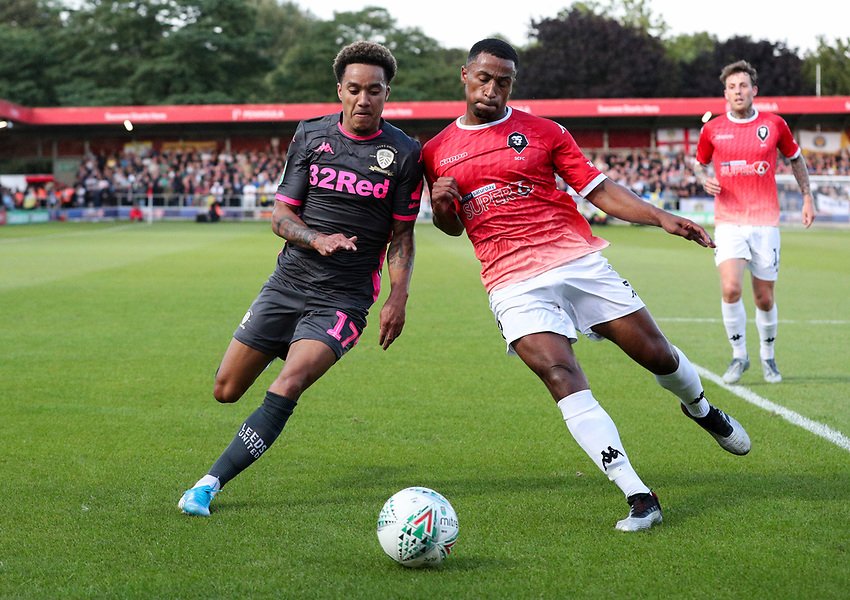 Leeds United's Helder Costa vies for possession with Salford City's Ibou Touray<br /> <br /> Photographer Alex Dodd/CameraSport<br /> <br /> The Carabao Cup First Round - Salford City v Leeds United - Tuesday 13th August 2019 - Moor Lane - Salford<br />  <br /> World Copyright © 2019 CameraSport. All rights reserved. 43 Linden Ave. Countesthorpe. Leicester. England. LE8 5PG - Tel: +44 (0) 116 277 4147 - admin@camerasport.com - www.camerasport.com